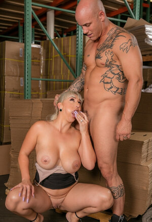 Serbian blonde with bulky knockers gives blowjob to glabrous warehouse worker