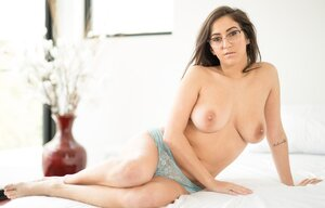 Chubby bookworm April Oneil smiles while showing juicy bra buddies and bush in bedroom