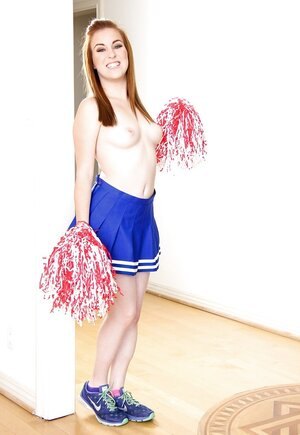 Pale-skinned broad bought sexy cheerleader uniform for hot striptease