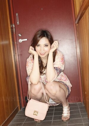 Comely Japanese gal flashes panties while waiting for buddy near door