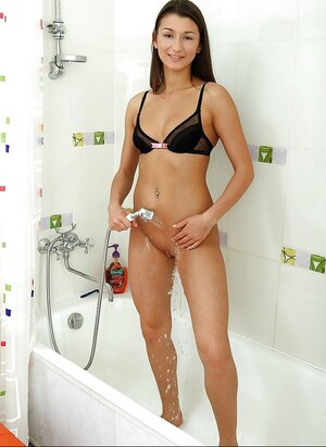 Lustful babe goes to the bathroom to shave slit and masturbates with water jet