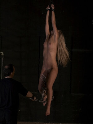 Master hangs small-tittied broad to the ceiling and leaves her in this way