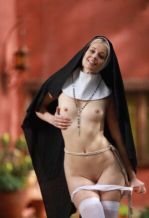 Skinny blonde nun provocatively shows small tits and furthermore cunny hidden under outfit