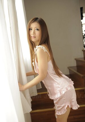 Tiny Japanese doll Uta Kohaku poses on the couch in gentle silk nightwear