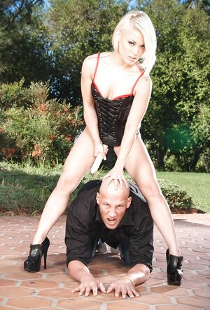 Domme Ash Hollywood dominates over shaved lover by forcing to give head strapon