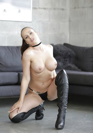Mind-blowing beauty Anastasiya Hart seductively demonstrates assets in living room